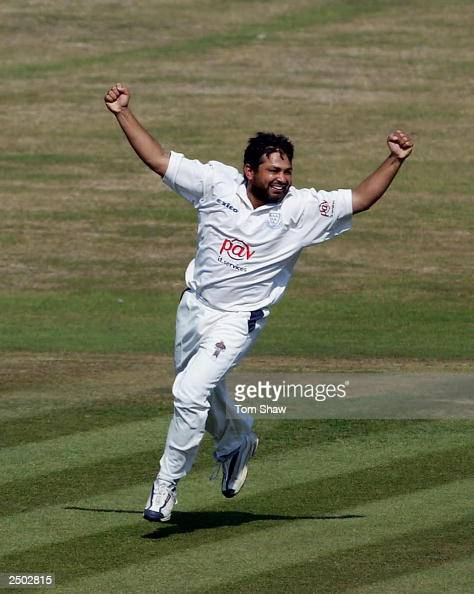 Mushtaq Ahmed of Sussex celebrates after taking his 100th first class wicket of the season that of Brad Hodge of Leicestershire on the First day of...