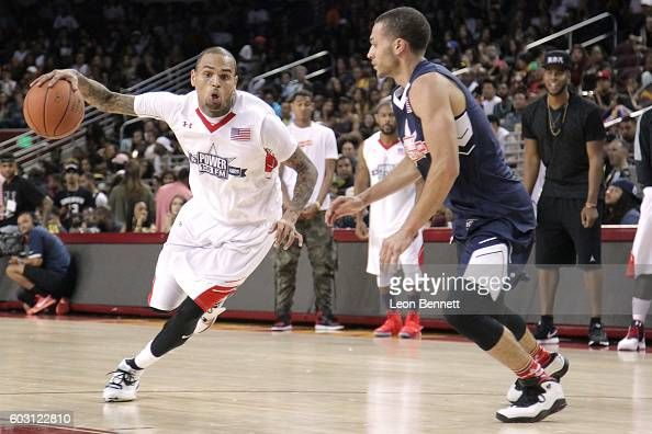 Music artist Chris Brown handles the ball against music artist Kalin White during 2016 Power 106 All Star Celebrity Basketball Game at USC Galen...