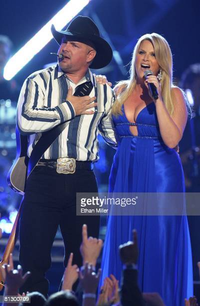 Music artist Garth Brooks and his wife singer Trisha Yearwood perform during the 43rd annual Academy of Country Music Awards at the MGM Grand Garden...