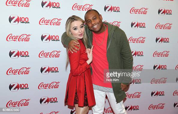 Music artist Sabrina Carpenter and Maxwell Jones pose for a photo together during Z100 CocaCola All Access Lounge at Z100's Jingle Ball 2016...