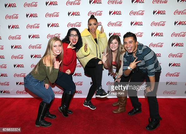 Music artist Tinashe poses for a photo with guests at Z100 CocaCola All Access Lounge at Z100's Jingle Ball 2016 Presented by Capital One preshow at...