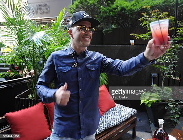 Music artist Yandel toasts as he celebrates the Puerto Rican Day Parade at China Grill on June 12 2016 in New York City