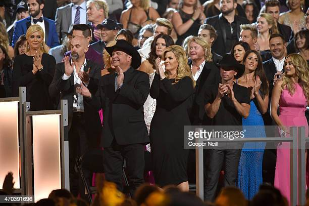 Music artists Garth Brooks Trisha Yearwood Phillip Sweet and Kenny Chesney attend the 50th Academy of Country Music Awards at ATT Stadium on April 19...