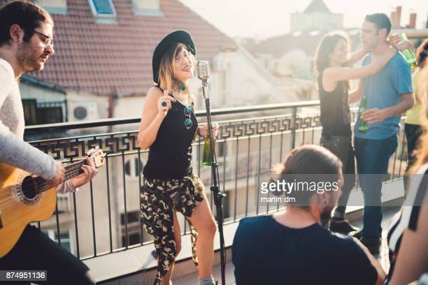 Music band performing on rooftop party