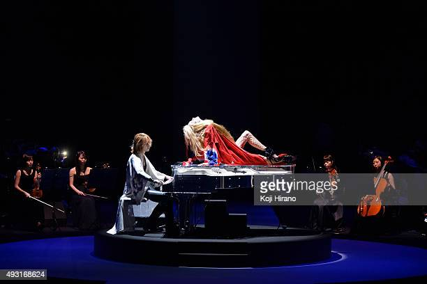 Music band X JAPAN leader and fashion designer YOSHIKI plays piano on the runway during the YOSHIKIMONO show as part of Mercedes Benz Fashion Week...