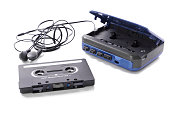 old-fashioned music cassette and walkman with earphones