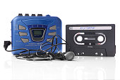 old-fashioned music cassette and walkman player with earphones
