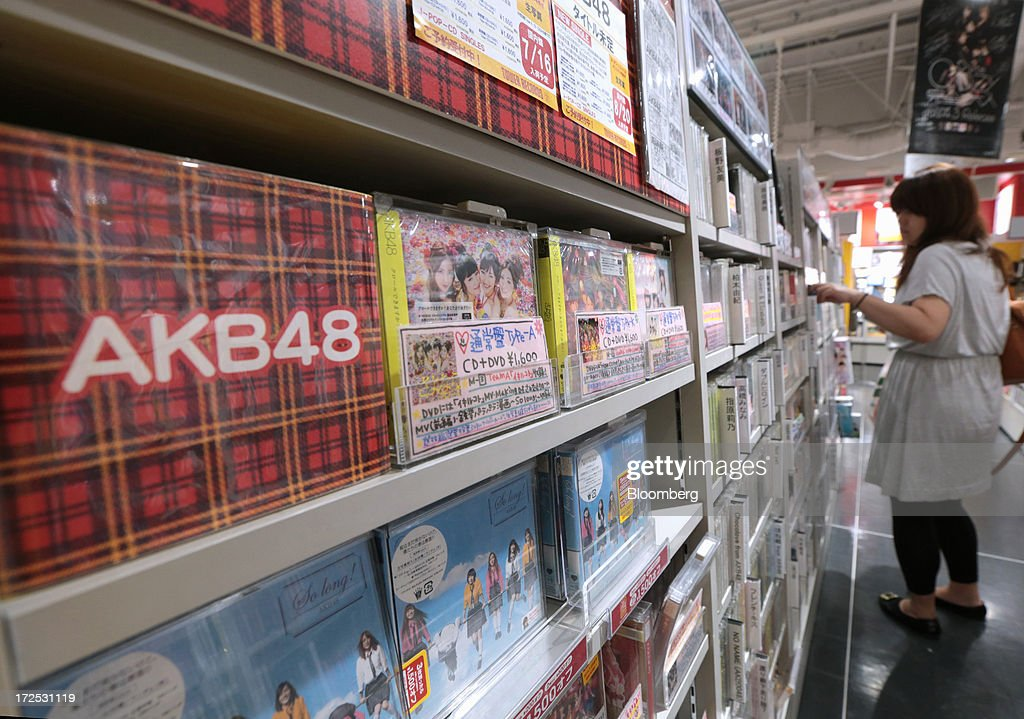 Music CDs and DVDs by 'AKB48', a Japanese girl group, are displayed on a shelf at a Tower Records Japan Inc. store in Tokyo, Japan, on Monday, July 1, 2013. Music sales in the country rose for the first time in five years, led by tunes delivered on CDs and other physical media, bucking the trend in developed markets as cheaper downloads gain ground. Physical media made up 82 percent of Japanese music sales last year, versus 37 percent in the U.S., said the Recording Industry Association of Japan. Photographer: Yuriko Nakao/Bloomberg via Getty Images