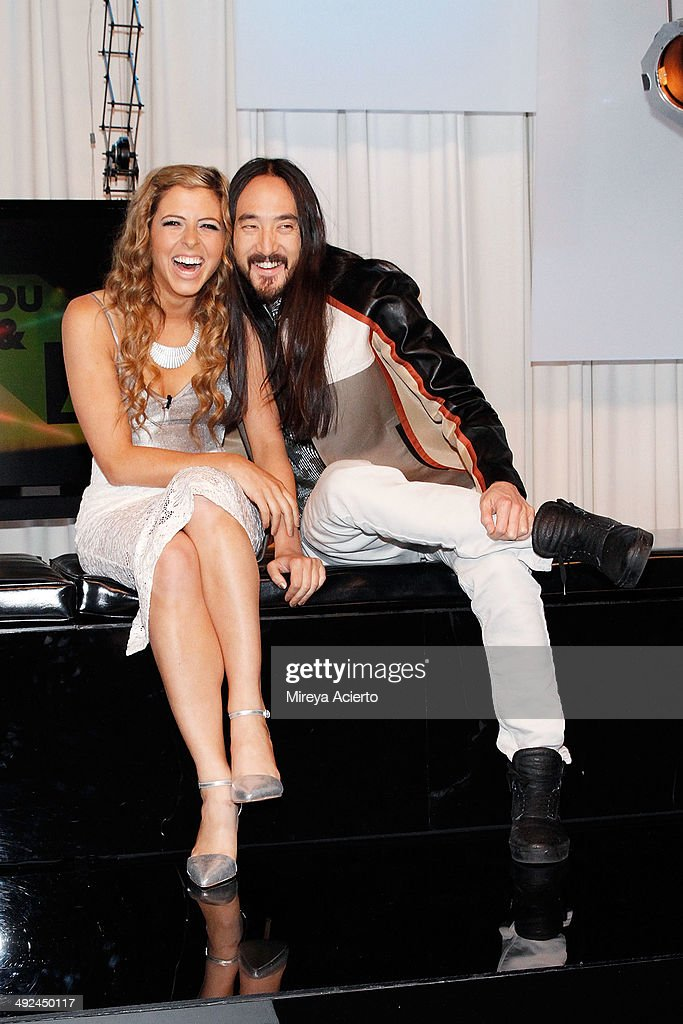 Music Choice host Clare Galterio and musician <a gi-track='captionPersonalityLinkClicked' href=/galleries/search?phrase=Steve+Aoki&family=editorial&specificpeople=732001 ng-click='$event.stopPropagation()'>Steve Aoki</a> visit Music Choice's 'You & A' on May 20, 2014 in New York, United States.