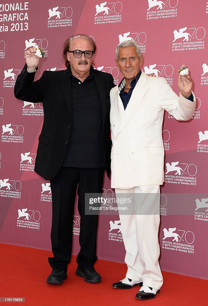 Music composer Pino Donaggio (L) and actor Enzo Staiola (R) attend the 'Non Eravamo Solo... Ladri Di Biciclette' Photocall during the 70th Venice International Film Festival at the Palazzo del Casino on September 1, 2013 in Venice, Italy.