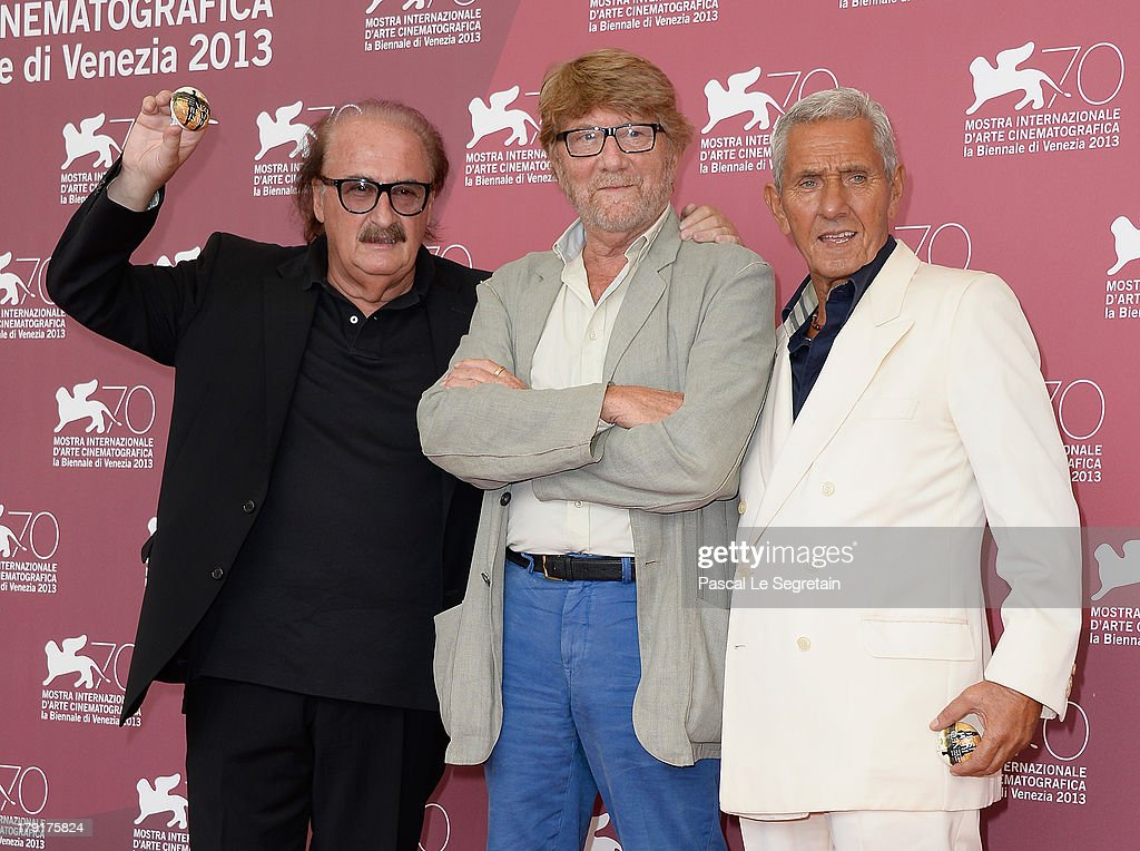 Music composer Pino Donaggio (L), director and producer Gianni Bozzacchi (C) and actor Enzo Staiola (R) attend the 'Non Eravamo Solo... Ladri Di Biciclette' Photocall during the 70th Venice International Film Festival at the Palazzo del Casino on September 1, 2013 in Venice, Italy.