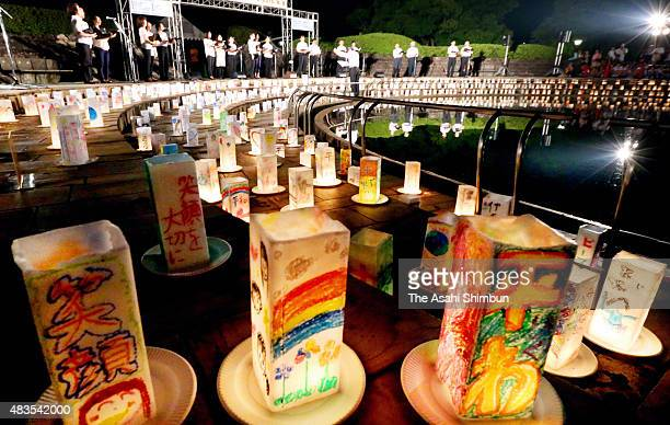 A music concert is held while candlelit paper lanterns are placed at Nagasaki Peace Park on August 8 2015 in Nagasaki Japan The world's second atomic...