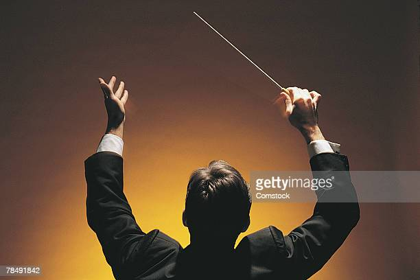 Music conductor with baton