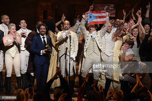 Music director Alex Lacamoire and actor composer LinManuel Miranda and cast of 'Hamilton' celebrate on stage the receiving of GRAMMY award after...