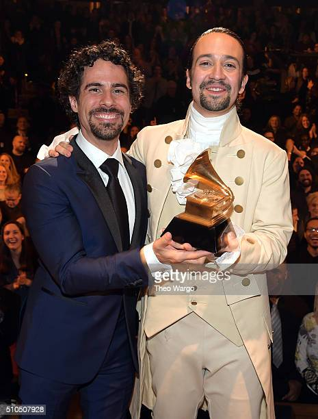 Music director Alex Lacamoire and Actor composer LinManuel Miranda celebrate on stage during 'Hamilton' GRAMMY performance for The 58th GRAMMY Awards...