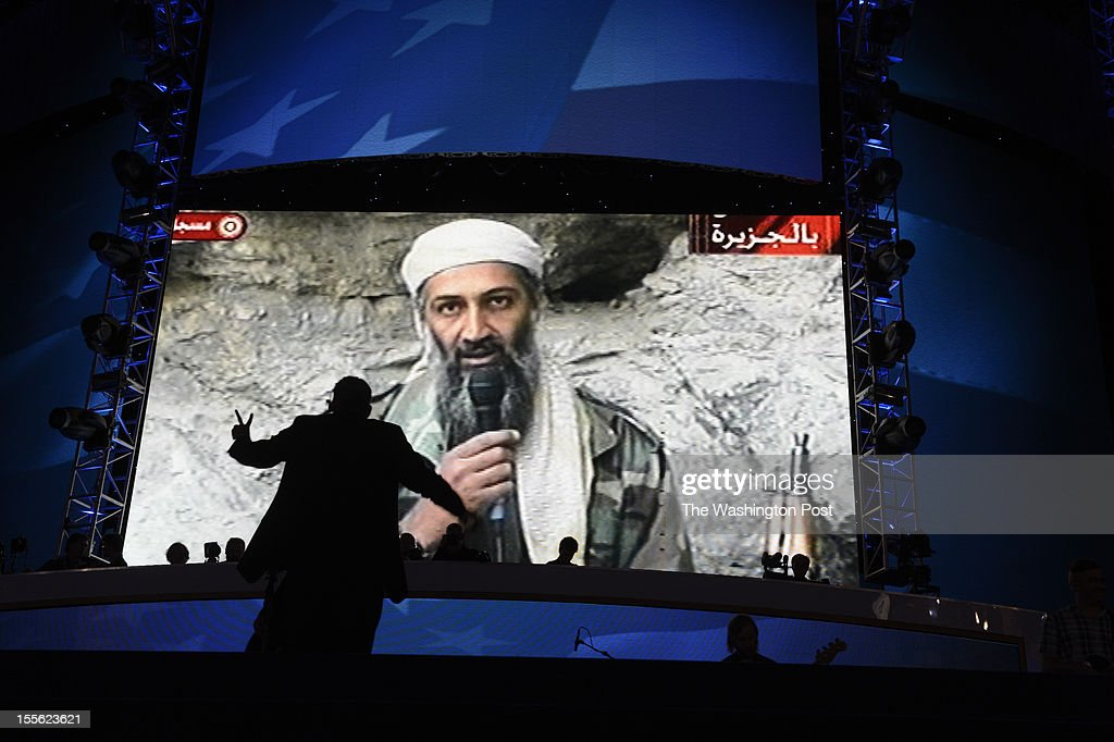 A music director is silhouetted conducting, as a video that included the capture of Osama Bin Laden plays on screen, at the Democratic National Convention in Charlotte, North Carolina, on Wednesday, September 5, 2012.