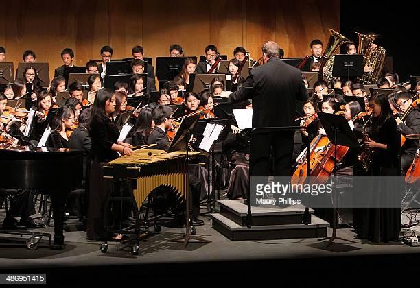 Music Director Steve Acciani and the Diamond Bar High School Symphony Orchestra perform during GRAMMY Signature School Presentation at Mt San Antonio...