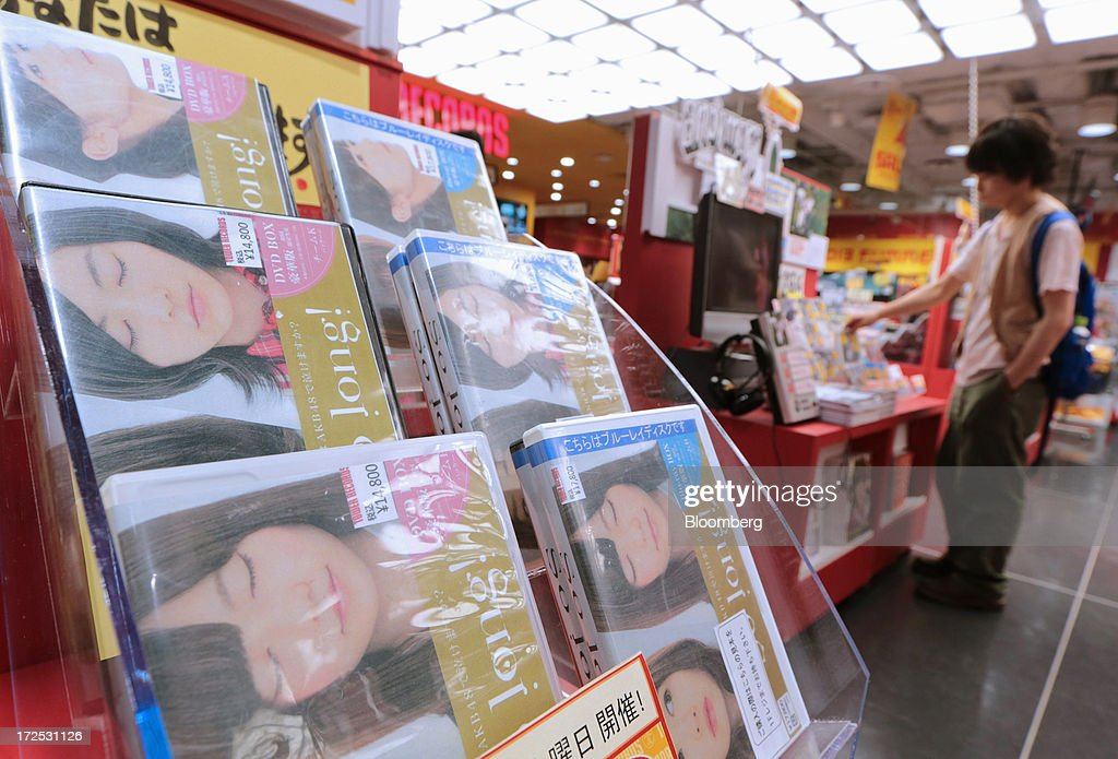 Music DVDs by 'AKB48', a Japanese girl group, are displayed on a shelf at a Tower Records Japan Inc. store in Tokyo, Japan, on Monday, July 1, 2013. Music sales in the country rose for the first time in five years, led by tunes delivered on CDs and other physical media, bucking the trend in developed markets as cheaper downloads gain ground. Physical media made up 82 percent of Japanese music sales last year, versus 37 percent in the U.S., said the Recording Industry Association of Japan. Photographer: Yuriko Nakao/Bloomberg via Getty Images