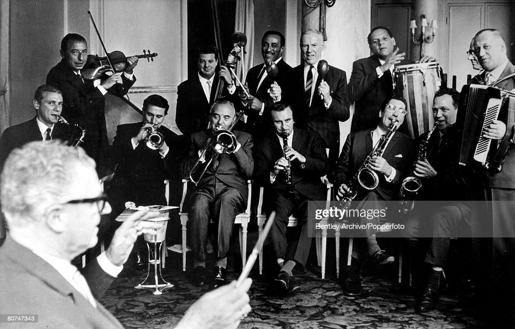 8th July 1963, London, Top bandleaders, l-r, David Ede, Joe Loss, Kenny Ball, Bill Shepherd, Ted Heath, Ray Ellington, Acker Bilk,Victor Silvester, Ken Mackintosh, Edmundo Ros, Bob Miller, Jack Payne, Eric Winstone under the direction of Jim Davidson, for who this Savoy Hotel lunch was organised