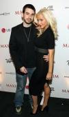 Music excecutive Jordan Bratman and singer Christina Aguilera arrive at the MAXIM Magazine 100th Issue Celebration at the Wynn Resort on April 8 2006...