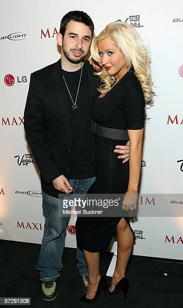 Music excecutive Jordan Bratman and singer Christina Aguilera arrive at the MAXIM Magazine 100th Issue Celebration at the Wynn Resort on April 8 2006...