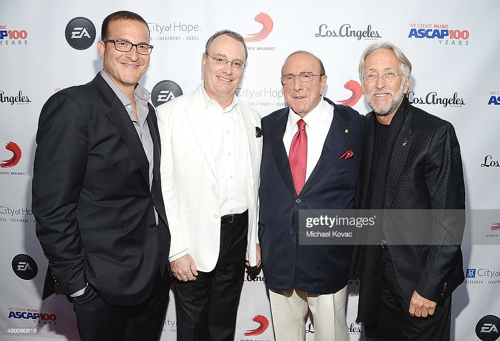 Music executive <a gi-track='captionPersonalityLinkClicked' href=/galleries/search?phrase=Doug+Davis&family=editorial&specificpeople=211598 ng-click='$event.stopPropagation()'>Doug Davis</a>, Spirit Music Group Chairman David Renzer, Producer <a gi-track='captionPersonalityLinkClicked' href=/galleries/search?phrase=Clive+Davis&family=editorial&specificpeople=209314 ng-click='$event.stopPropagation()'>Clive Davis</a> and National Academy of Recording Arts and Sciences President <a gi-track='captionPersonalityLinkClicked' href=/galleries/search?phrase=Neil+Portnow&family=editorial&specificpeople=208909 ng-click='$event.stopPropagation()'>Neil Portnow</a> arrive at City of Hope's 10th Anniversary 'Songs Of Hope' on June 4, 2014 in Brentwood, California.