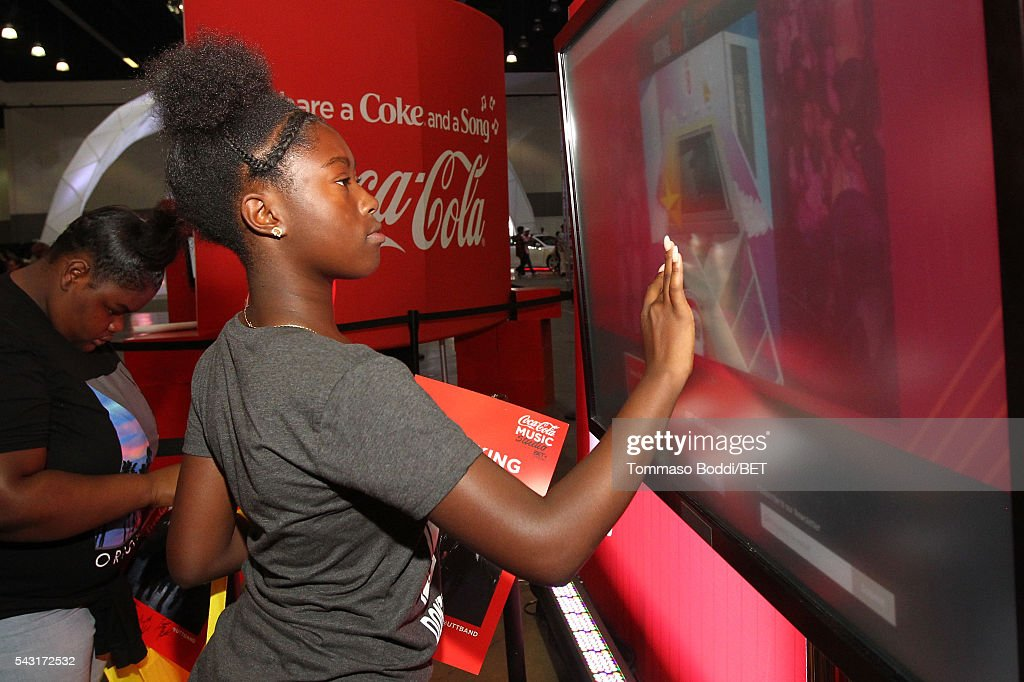 Music fan attends the Coke music studio during the 2016 BET Experience on June 26, 2016 in Los Angeles, California.