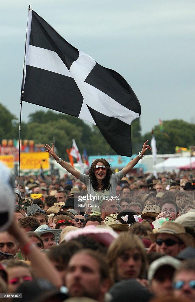 A music fan cheers The Kooks as they perform on the third and final day of the Isle of Wight Festival on June 15 2008 in Newport Isle of Wight...