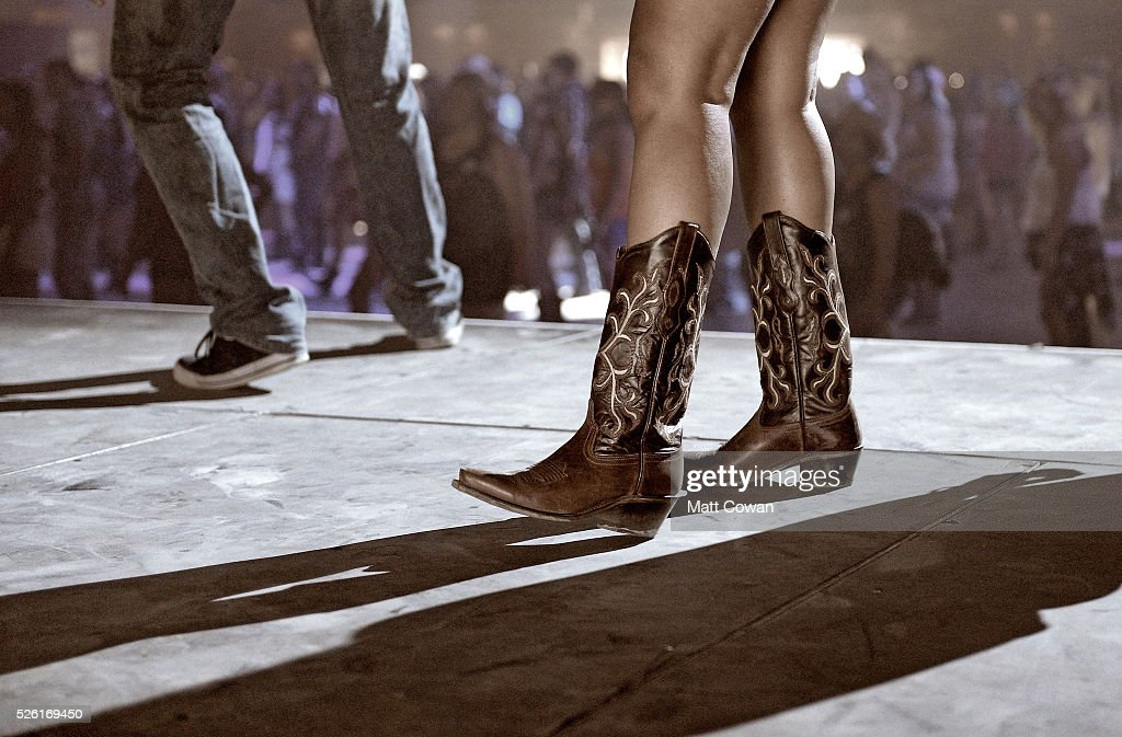 Music fan dances onstage during the performance of DJ Jack at 2016 Stagecoach California's Country Music Festival at Empire Polo Club on April 29, 2016 in Indio, California.