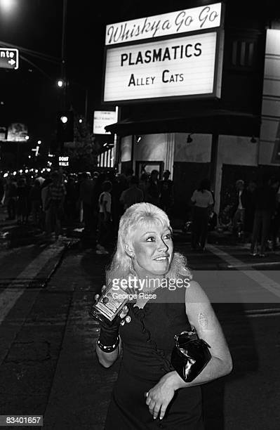 A music fan drinks tequila outside the famed Whiskey a Go Go Club on the Sunset Boulevard in this 1980 Hollywood California photo