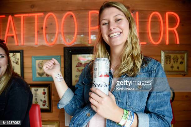 A music fan gets a Budweiser temporary tattoo in the Bud Block area during the 2017 Budweiser Made in America festival Day 1 at Benjamin Franklin...
