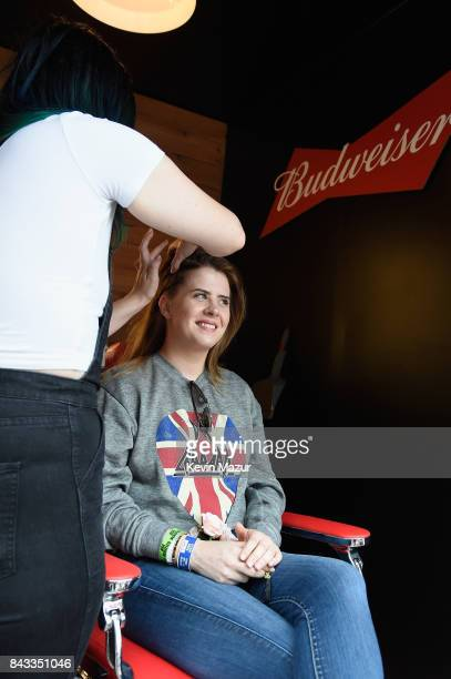 A music fan has her hair braided in the Bud Block area during 2017 Budweiser Made in America Day 1 at Benjamin Franklin Parkway on September 2 2017...