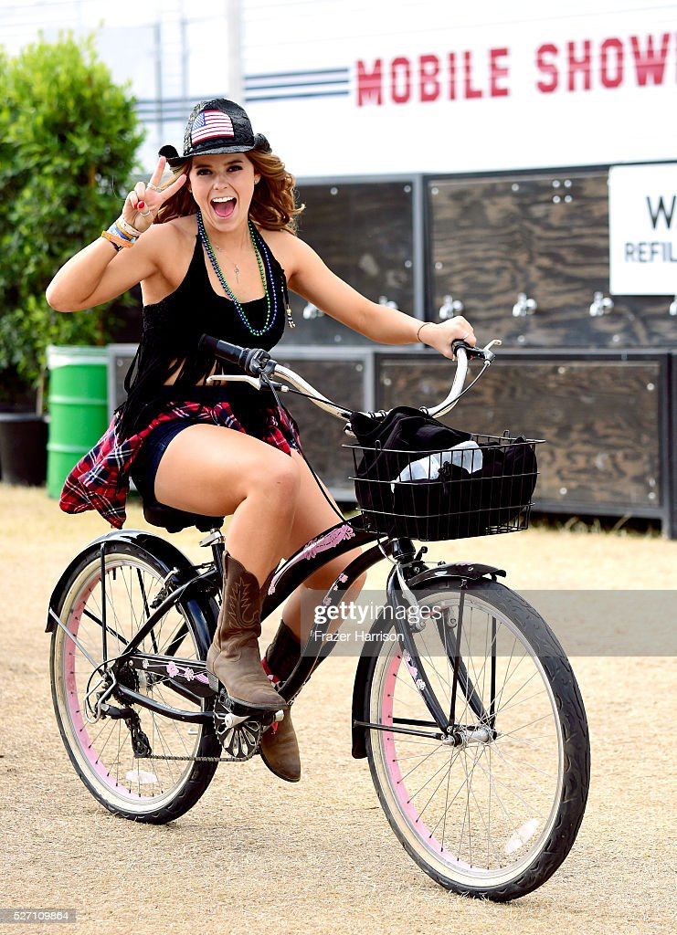A music fan is seen on a bicycle during 2016 Stagecoach California's Country Music Festival at Empire Polo Club on May 01, 2016 in Indio, California.