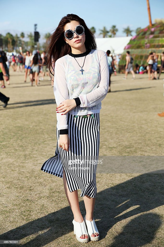 Music fan Jynng of China attends day 3 of the 2014 Coachella Valley Music & Arts Festival at the Empire Polo Club on April 20, 2014 in Indio, California.