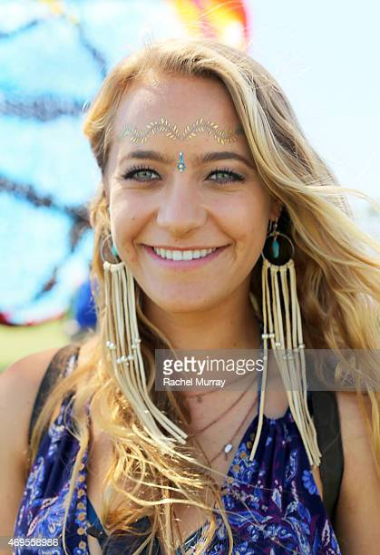 Music fan Niklle Lovaas wearing Makha Jewels earings and gold foil tattoos attends the 2015 Coachella Valley Music and Arts Festival Weekend 1 at The...