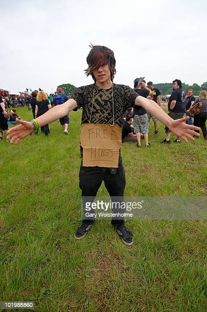 A music fan offers free hugs on the first day of Download Festival at Donington Park on June 11 2010 in Derby England