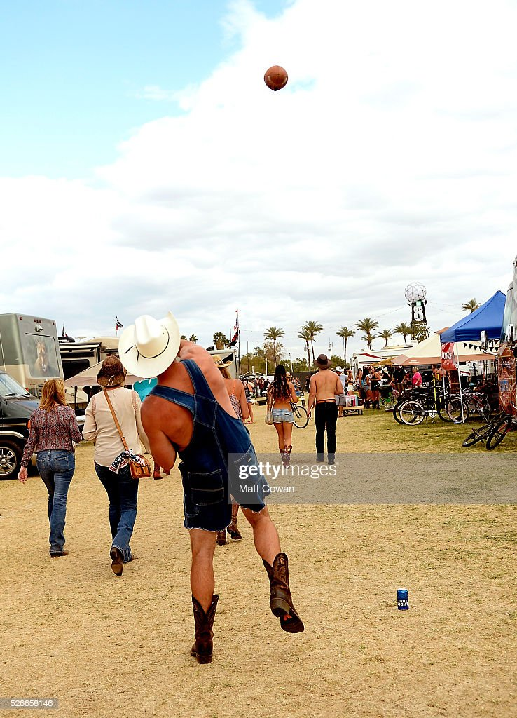 A music fan plays football during 2016 Stagecoach California's Country Music Festival at Empire Polo Club on April 30, 2016 in Indio, California.