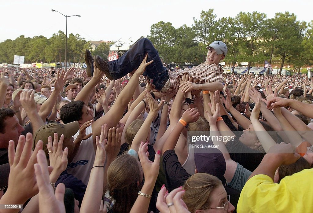 A music fan rides a sea of hands during a performance by the band Cowboy Mouth at the10th Annual Music Midtown Festival May 3, 2003 in Atlanta, Georgia. The three-day music festival features a variety of national acts.
