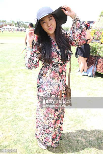 Music Fan Sally Yun of Los Angeles wearing a dress from Shop Luna B attends day 1 of the 2014 Coachella Valley Music Arts Festival at the Empire Polo...