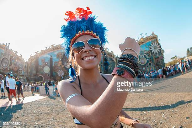 Music fan shows her tomorrowland bracelet during the second day of the Tomorrowland music festival at Parque Maeda Itu on April 22 2016 in Sao Paulo...