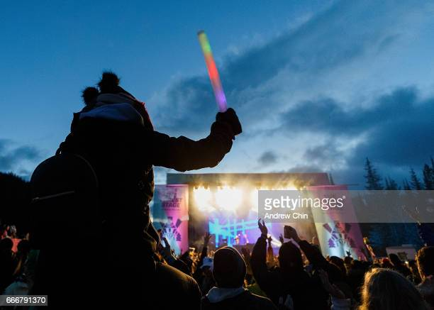 A music fan sits on top of her partner's shoulder while watching Australian electronic music duo Peking Duk's performance on stage during Day 4 of...