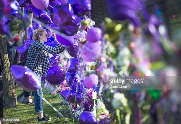 A music fan visits a memorial created outside Paisley Park the home and studio of Prince on April 23 2016 in Chanhassen Minnesota Prince was...