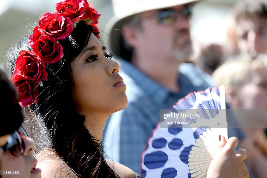 Music fan watches as Surfer Blood performs onstage during day 3 of the 2014 Coachella Valley Music & Arts Festival at the Empire Polo Club on April 13, 2014 in Indio, California.