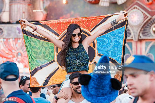 Music fan with a Tomorrowland flag during the third day of the Tomorrowland music festival at Parque Maeda Itu on April 23 2016 in Sao Paulo Brazil