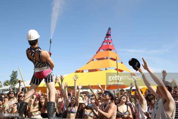 Music fans are hosed as they dance during day 2 of the 2013 Coachella Valley Music Arts Festival at the Empire Polo Club on April 13 2013 in Indio...