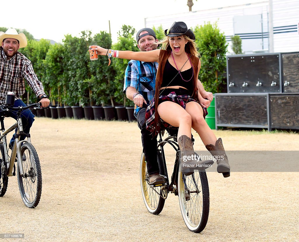 Music fans are seen on a bicycle during 2016 Stagecoach California's Country Music Festival at Empire Polo Club on May 01, 2016 in Indio, California.