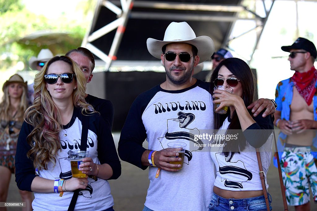 Music fans are seen wearing Midland shirts at 2016 Stagecoach California's Country Music Festival at Empire Polo Club on May 01, 2016 in Indio, California.