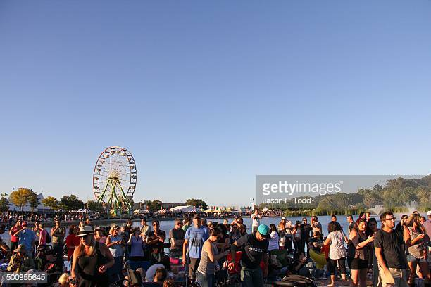 Music fans at the Marin County Fourth of July Fair in San Rafael California w Ferris wheel