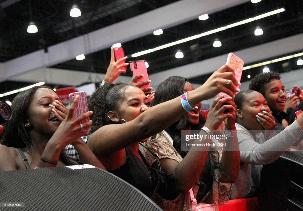 Music fans attend the performance of recording artist Jacquees at the Coke music studio during the 2016 BET Experience on June 25, 2016 in Los Angeles, California.