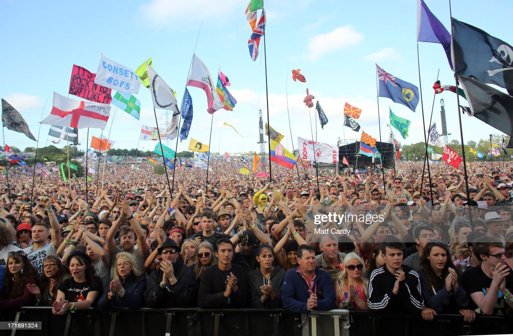 Music fans cheer as Primal Scream perform on the Pyramid Stage at the Glastonbury Festival of Contemporary Performing Arts site at Worthy Farm, Pilton on June 29, 2013 near Glastonbury, England. The wholesale market caters for traders throughout the Festival who are estimated to provide 3 million meals for festival goers, crew and performers. Gates opened on Wednesday at the Somerset diary farm that will be playing host to one of the largest music festivals in the world and this year features headline acts Artic Monkeys, Mumford and Sons and the Rolling Stones. Tickets to the event which is now in its 43rd year sold out in minutes and that was before any of the headline acts had been confirmed. The festival, which started in 1970 when several hundred hippies paid 1 GBP to watch Marc Bolan, now attracts more than 175,000 people over five days.
